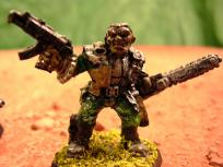 I was still using enamels when I did these. This guy has a SMG and a combat chainsaw.
