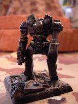 Specialised siege robot from early days of 40K. It's missing the weapon on the back, because I converted this as a part of a fantasy battle project... that never got anywhere, as you might have guessed.