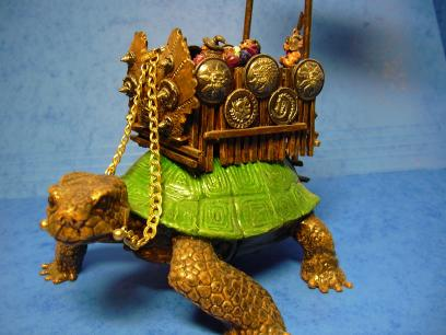 The howdah is scratch-built using matchsticks, plastic shields and the front piece is from a Grenadier war machine set.