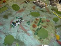 Infantry assault creeps through the forest to surprise the defenders.