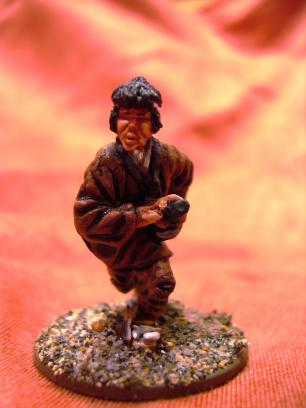 Another samurai. This is not 100% kosher 3-color one, though. The brown cloth is based on a Vallejo color and inkwashed before painting in the highlight. I simply squirted too much Vallejo brown and had to use it somewhere...