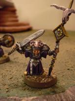 Standard bearer, the only guy with a face.