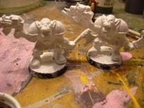 Undercoated with white gesso. Niilo's patience isn't quite long enough for the painting yet. Yes, they are those horrid Space Crusade figures.