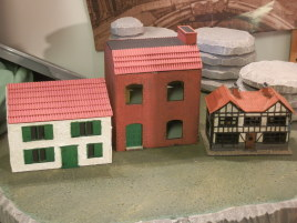 A quick comparison of house sizes. These are all supposed to be two-story houses. On the left there is a Warbases modular house, in the middle Warbases mansard roof house and on the right Dapol's OO scale country inn.