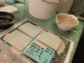 Casting more tiles.